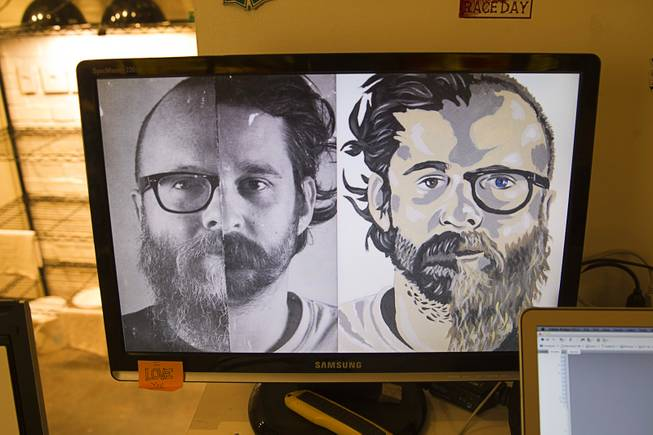 A composite photo and artwork based on photographer Todd Duane Miller, left side, and artist JW Caldwell is displayed on a computer monitor in the P3 Studio in the Cosmopolitan Monday, July 21, 2014. For their project, Miller combines portraits of people and Caldwell creates artwork from the composite photos.