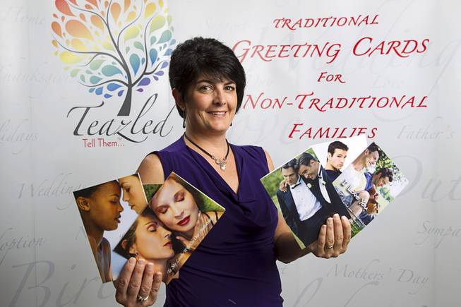 "Teazled CEO Dina Proto poses with greeting cards at her office Monday, July 21, 2014. Teazled is a company that makes ""traditional greeting cards for nontraditional familes."""