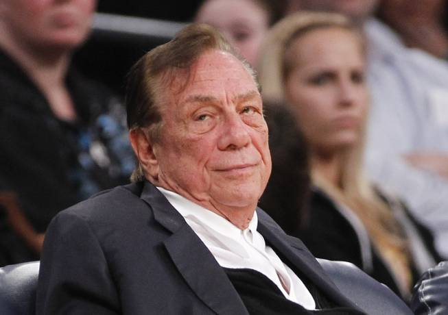 FILE - In this Dec. 19, 2011 file photo, Los Angeles Clippers owner Donald Sterling watches the Clippers play the Los Angeles Lakers during an NBA preseason basketball game in Los Angeles. The future of the Clippers is closer to decision as testimony resumes Monday, July 21, 2014, in a probate trial over whether a deal negotiated by Donald Sterling's estranged wife to sell the team for $2 billion is authorized under a Sterling family trust.