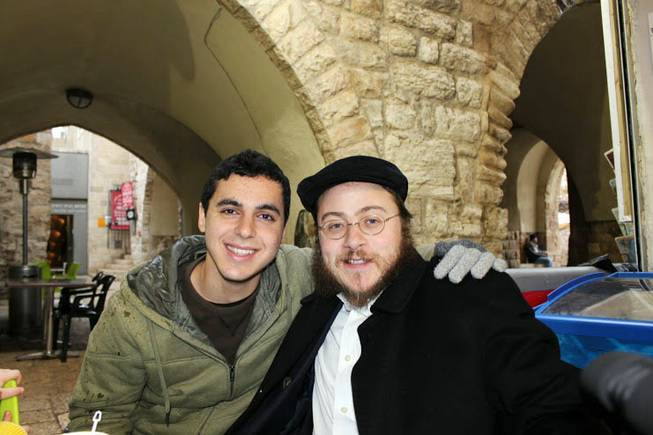 This 2012 photo provided by Rabbi Asher Hecht, shows Nissim Sean Carmeli, left, with Hecht in Jerusalem. The Israel Defense Forces said Sunday, July 20, 2014, in a statement that Carmeli was killed in combat in the Gaza Strip. Carmeli was from South Padre Island, Texas, said Deputy Consul General of Israel to the Southwest Maya Kadosh.
