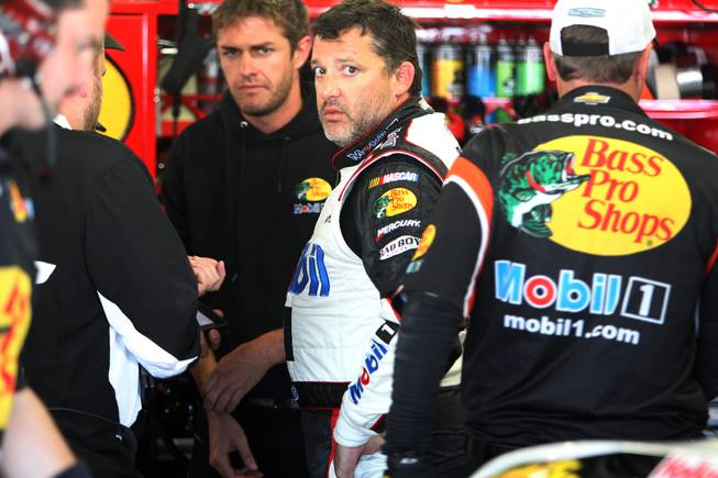 Driver Tony Stewart talks with his crew after practice Saturday, July 12, 2014, for the Sprint Cup Series at New Hampshire Motor Speedway in Loudon, N.H.
