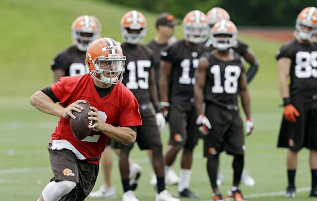 Cleveland Browns quarterback Johnny Manziel runs the ball during NFL mini camp at the team's facility in Berea, Ohio, on June 11, 2014.