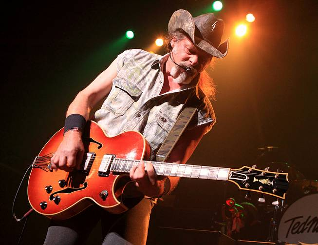 This Aug. 16, 2013, file photo shows Ted Nugent performing at Rams Head Live in Baltimore. A Native American tribe has canceled an Aug. 4, 2014, concert by Nugent at its casino.