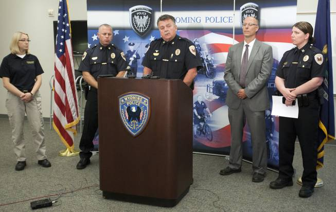 Wyoming police Chief James Carmody, middle, holds a press conference about the triple homicide of Charles Oppenneer, Brooke Slocum and her unborn child at the Wyoming, Mich., Police Department Monday, July 21, 2014.