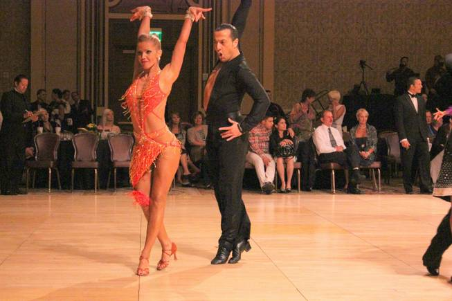 Tania Reis and Vartan Zakhariants dance together at the Nevada Star Ball held at the Green Valley Ranch Hotel in August 2013. Zakhariants owns Las Vegas'  VZ Dance Studio and Reis is a teacher there.