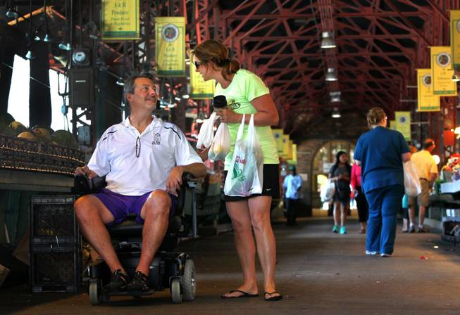 Dave Larson, who suffers from amyotrophic lateral sclerosis, and his wife, Ann, shop in St. Louis. Larson got his ALS diagnosis in January 2013 after dealing with slurred speech and having issues swallowing.
