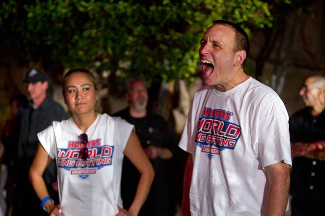 "Las Vegan Miki Sudo and Joey Chestnut prepare for competition during the 2014 Hooters ""World-Wide Wing Eating Championship"" at the Hard Rock pool Tuesday, July 22, 2014."