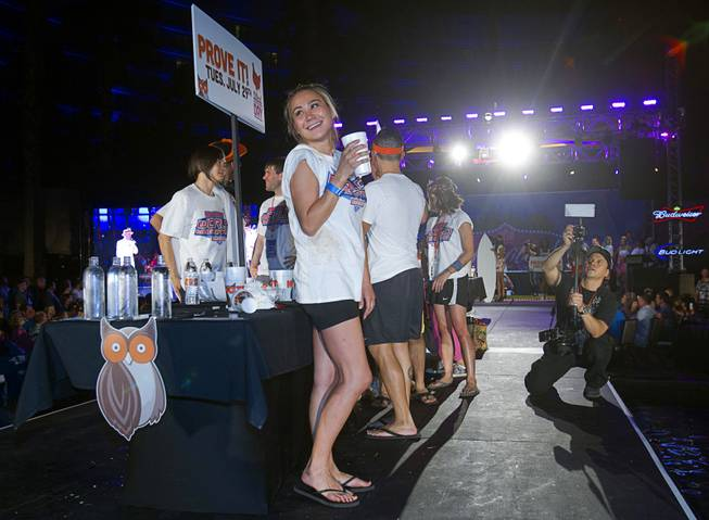"Professional eater Miki Sudo of Las Vegas smiles after competing in the 2014 Hooters ""World-Wide Wing Eating Championship"" at the Hard Rock pool Tuesday, July 22, 2014."