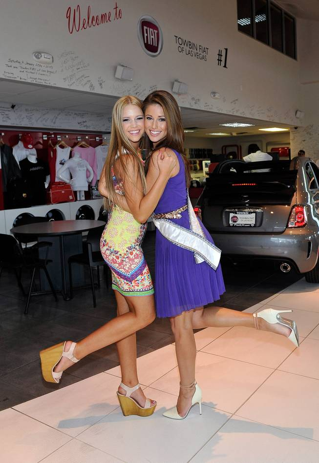 Miss Nevada Teen USA Alexa Taylor (L) and Miss USA 2014 Nia Sanchez appears at an official Miss Nevada USA recruitment event at Towbin Fiat of Las Vegas on July 19, 2014 in Las Vegas, Nevada.