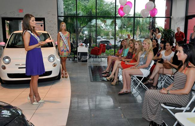 Miss USA 2014 Nia Sanchez (L) speaks during an official Miss Nevada USA recruitment event at Towbin Fiat of Las Vegas on July 19, 2014 in Las Vegas, Nevada.