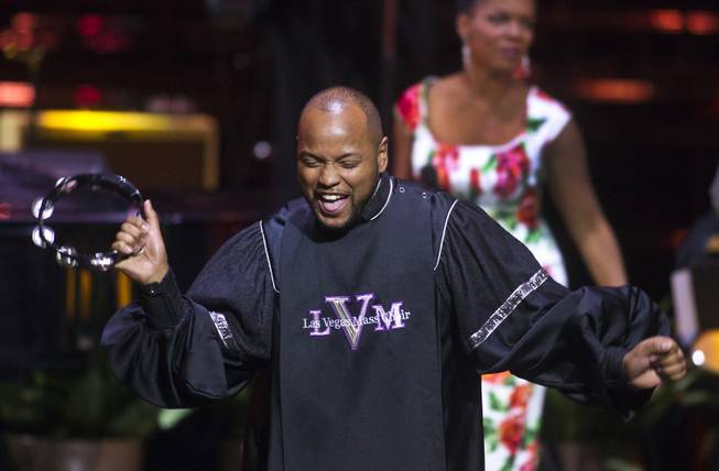 "A member of the Las Vegas Mass Choir performs for the crowd during The Venetian Las Vegas announcement event for the engagement of ""Georgia On My Mind: The Music of Ray Charles"" on Tuesday, July 22, 2014."