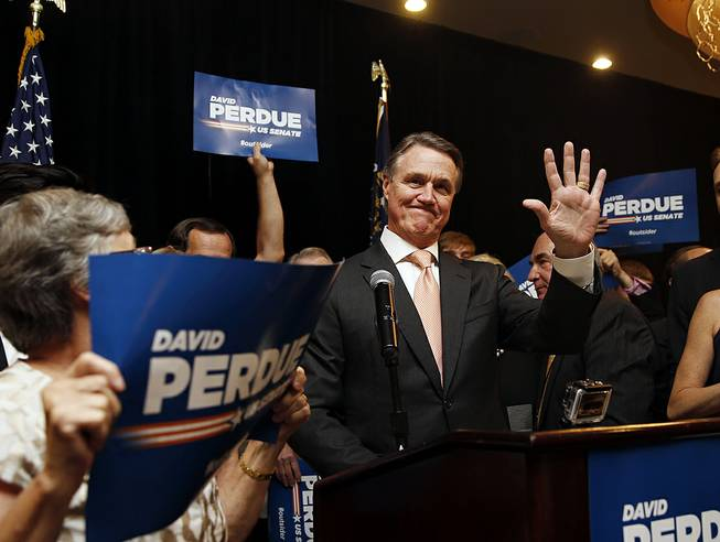 David Perdue waves to supporters after declaring victory in the Republican primary runoff for nomination to the U.S. Senate from Georgia, at his election-night party in Atlanta, Tuesday, July 22, 2014. Perdue defeated Rep. Jack Kingston.