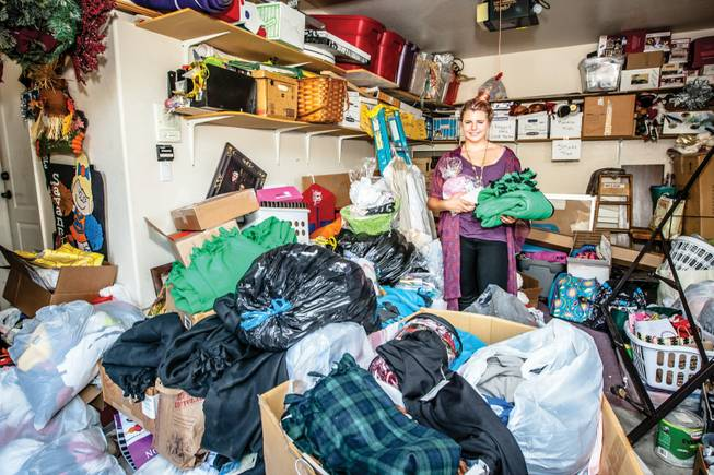 "Dedicated to helping at-risk teens, co-founder 14-year-old Siena Prenger stands in a packed garage of clothing, school supplies, homemade blankets and hygiene kits collected as part of her nonprofit ""Teens Helping Teens"" at her home in North Las Vegas."