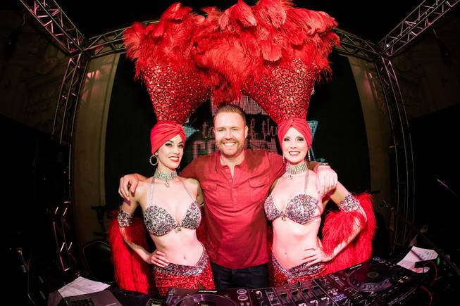 DJ Ikon with Las Vegas Showgirls at Tales of the Cocktail  at the Masquerade Nightclub inside Harrahs New Orleans on Thursday, July 17, 2014.