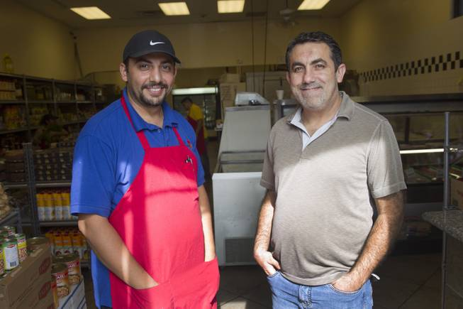 "Business partners Ghazwan ""Gino"" Salem, left, of Iraq, and Abdul Nasser Karouni of Lebanon pose at the Afandi Restaurant and Market, 5181 W. Charleston Blvd., Tuesday, July 15, 2014. STEVE MARCUS"