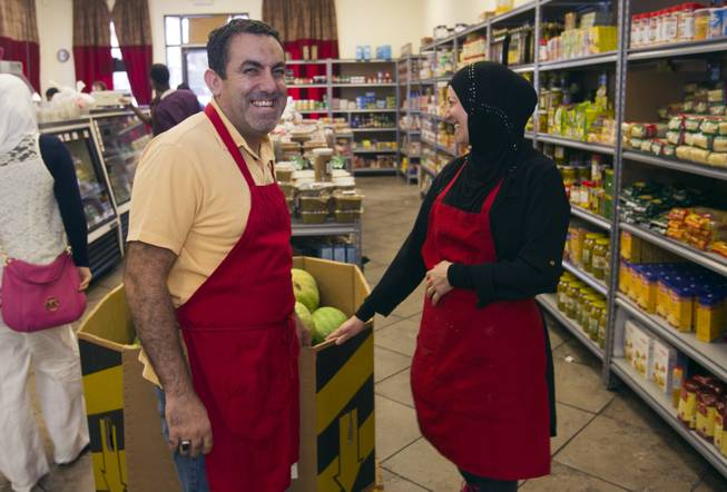 Abdul Nasser Karouni is shown with his wife Marian at the Afandi Restaurant and Market, 5181 W. Charleston Blvd., Tuesday, July 15, 2014. His wife was granted citizenship over a year ago but Abdul is still waiting.