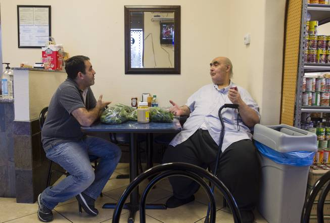 Businessman Abdul Nasser Karouni, left, talks with his friend Wadie Soliman, originally of Egypt, at the Afandi Restaurant and Market, 5181 W. Charleston Blvd., Wednesday, July 16, 2014. Karouni's wife was granted citizenship over a year ago but Karouni is still waiting. STEVE MARCUS