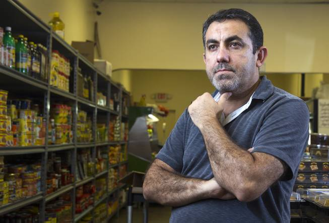 "Businessman Abdul Nasser Karouni poses at the Afandi Restaurant and Market, 5181 W. Charleston Blvd., Wednesday, July 16, 2014. Karouni's wife was granted citizenship over a year ago but Karouni is still waiting. Karouni owns Alfandi with his business partner Ghazwan ""Gino"" Salem. STEVE MARCUS"