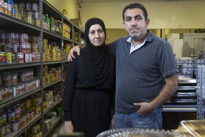 "Businessman Abdul Nasser Karouni poses with his wife Mirian at the Afandi Restaurant and Market, 5181 W. Charleston Blvd., Wednesday, July 16, 2014. Mirian was granted citizenship over a year ago but Karouni is still waiting. Karouni owns Alfandi with his business partner Ghazwan ""Gino"" Salem. STEVE MARCUS"
