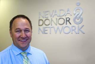 Brent Bergquist, director of ocular services at the Nevada Donor Network, poses at the Network offices Tuesday, July 22, 2014.