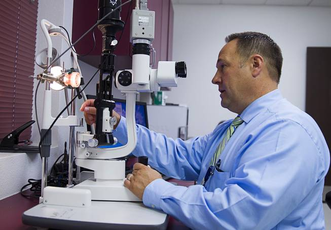 Brent Bergquist, director of ocular services at the Nevada Donor Network, uses slit lamp microscope to check a cornea at the Network offices Tuesday, July 22, 2014.