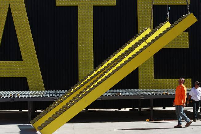 A worker watches as the W is lowered after the unveiling of the new Westgate Resorts sign for the former LVH Wednesday, July 22, 2014.
