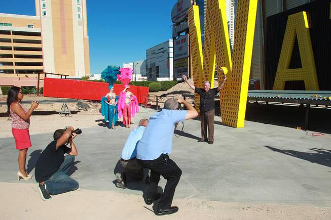 Westgate Resorts founder David Siegel has his photo taken at the unveiling of the sign for the former LVH on Wednesday, July 22, 2014.