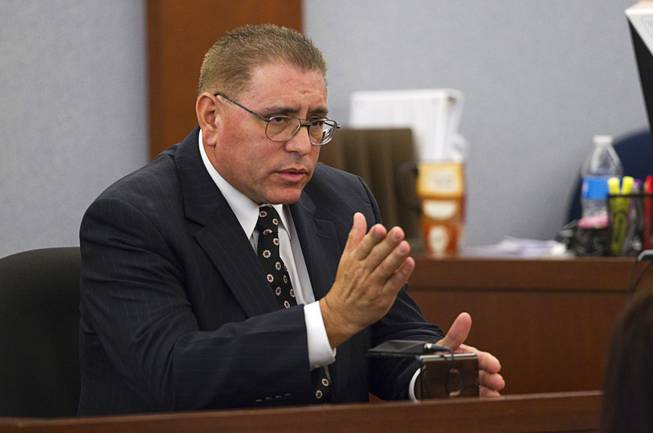 "Carlos Flores, father of Deborah Flores Narvaez, speaks during sentencing for Jason Griffith at the Regional Justice Center Wednesday, July 23, 2014. The former Las Vegas Strip performer was found guilty of second-degree murder in the 2010 death and dismemberment of his ex-girlfriend Deborah Flores Narvaez, a dancer in Luxor's topless ""Fantasy"" revue."