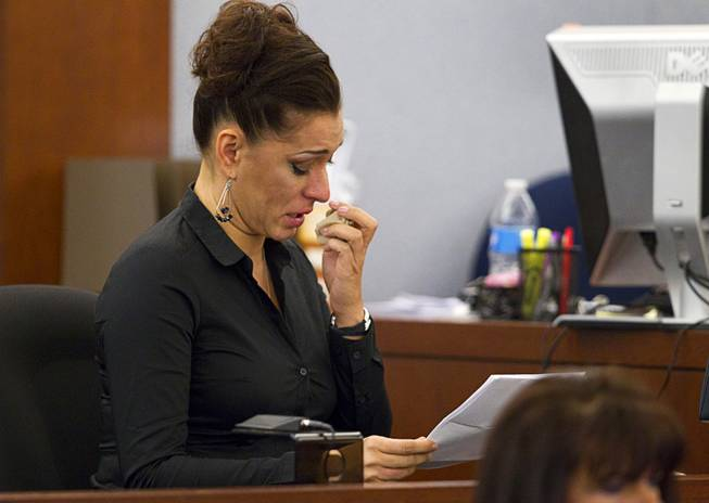 "Celeste Flores Narvaez, older sister of Deborah Flores Narvaez, reads a statement during sentencing for Jason Griffith at the Regional Justice Center Wednesday, July 23, 2014. The former Las Vegas Strip performer was found guilty of second-degree murder in the 2010 death and dismemberment of his ex-girlfriend Deborah Flores Narvaez, a dancer in Luxor's topless ""Fantasy"" revue."