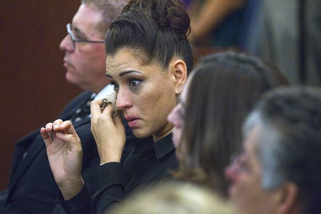 "Celeste Flores Narvaez, older sister of Deborah Flores Narvaez, wipes away a tear during sentencing for Jason Griffith at the Regional Justice Center Wednesday, July 23, 2014. The former Las Vegas Strip performer was found guilty of second-degree murder in the 2010 death and dismemberment of his ex-girlfriend Deborah Flores Narvaez, a dancer in Luxor's topless ""Fantasy"" revue."
