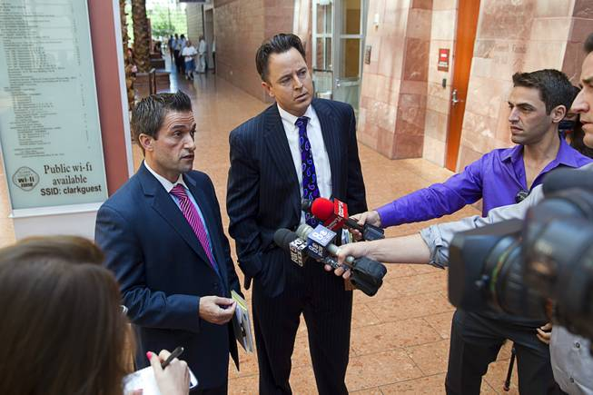 "Abel Yanez, left, and Jeff Banks, defense attorneys for Jason Griffith, speak to reporters after  Griffith was sentenced to life in prison at the Regional Justice Center Wednesday, July 23, 2014. The former Las Vegas Strip performer was found guilty of second-degree murder in the 2010 death and dismemberment of his ex-girlfriend Deborah Flores Narvaez, a dancer in Luxor's topless ""Fantasy"" revue."