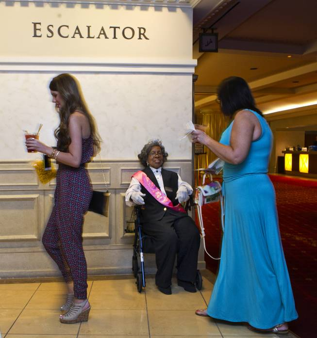 Colosseum usher Dorothy Brooks greets and directs show attendees before the Shania show at Caesars Palace on Wednesday, July 23, 2014.  Brooks turned 90 today and was thrown a birthday party there before opening for the evening.