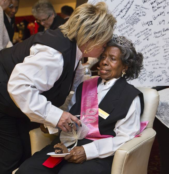 Colosseum usher Dorothy Brooks is kissed by usher Linda Flathau as she turns 90 today and is thrown a birthday party there before the Shania show at Caesars Palace on Wednesday, July 23, 2014.