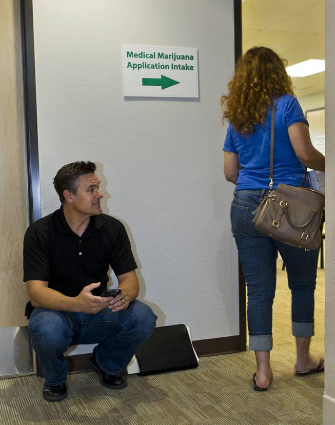 Tony Ricco joins others in waiting to be processed on the  last day to submit applications to the Las Vegas Department of Planning for medical marijuana dispensaries, cultivation or production on Wednesday, July 23, 2014.