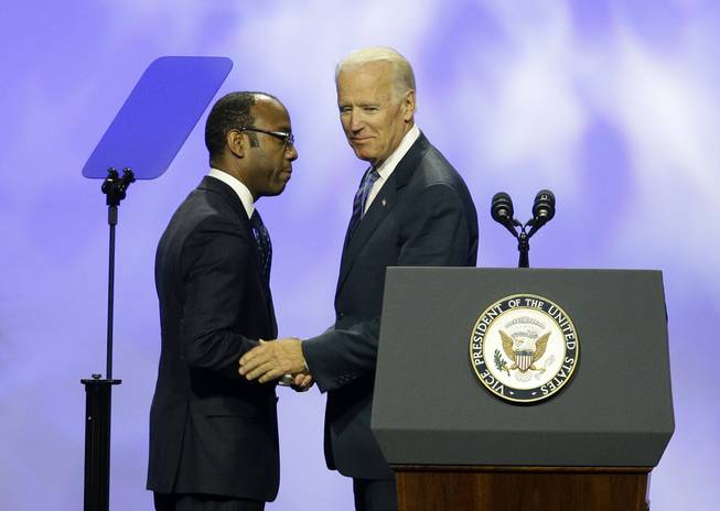 Vice President Joe Biden, right, shakes hands with NAACP President and CEO Cornell William Brooks at the NAACP annual convention Wednesday, July 23, 2014, in Las Vegas.