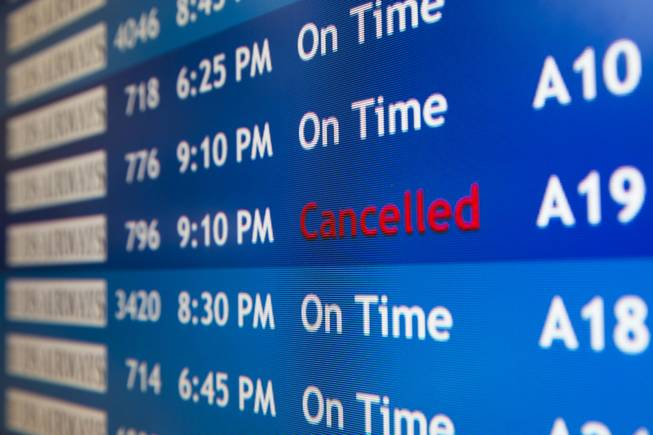 A departure board at the Philadelphia International Airport shows that US Airways Flight 796 to Tel Aviv has been canceled, Tuesday, July 22, 2014, in Philadelphia.