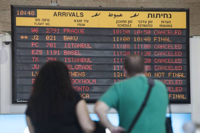 An arrivals flight board displays various canceled and delayed flights at Ben Gurion International Airport a day after the U.S. Federal Aviation Administration imposed a 24-hour restriction on flights in Tel Aviv, Israel, Wednesday, July 23, 2014.