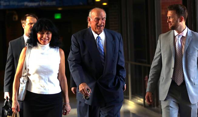Former Minnesota Gov. Jesse Ventura, center, arrives at court with his wife, Terry, and others Tuesday, July 22, 2014, in St. Paul, Minn.