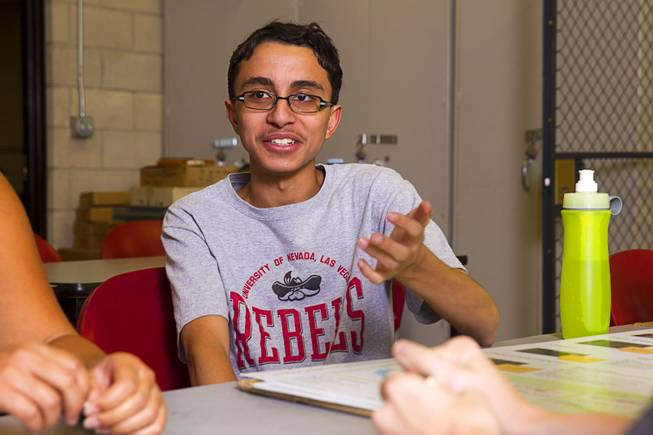 "Kareem Trabia, an A-Tech High School senior, speaks during an interview at UNLV Thursday, July 17, 2014. An engineering team at UNLV is designing a ""robohand"" for 4-year-old Hailey Dawson using the school's 3D printer. Dawson was born with a birth defect that left her only with a thumb and pinky on her left hand."
