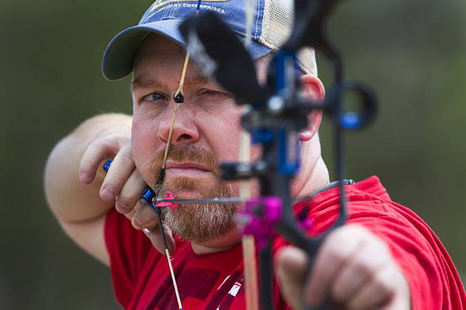 Jeremy Beard, president of the Las Vegas Archers, takes aim at the Las Vegas Archers Spring Mountain Range near Mountain Springs Sunday, July 20, 2014.
