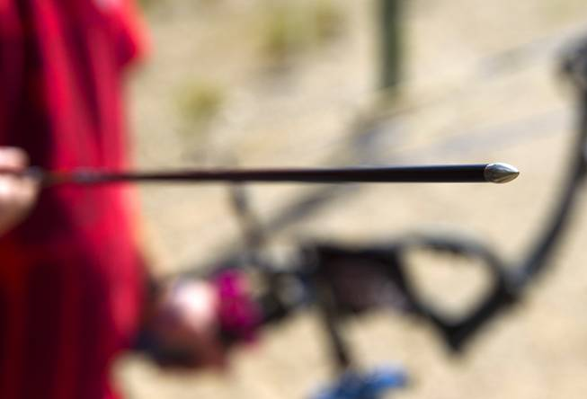 Jeremy Beard displays an arrow with a tungsten point at the Las Vegas Archers Spring Mountain Range near Mountain Springs Sunday, July 20, 2014.