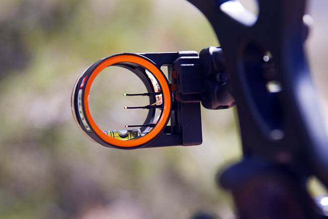 A bow sight is shown on a compound bow at the Las Vegas Archers Spring Mountain Range near Mountain Springs Sunday, July 20, 2014.