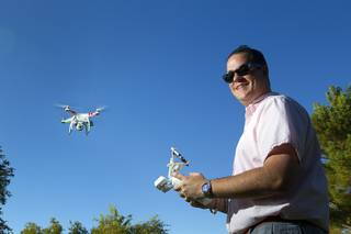 Earl Brown flies his DJI Phantom 2 Vision quadcopter drone at The Hills Park in Summerlin Thursday, July 24, 2014.  Brown turned to Craigslist after losing the drone on a flight earlier in the month.