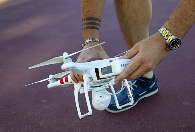 Earl Brown puts a fresh battery in his DJI Phantom 2 Vision quadcopter drone at The Hills Park in Summerlin Thursday, July 24, 2014.  Brown turned to Craigslist after losing the drone on a flight earlier in the month.