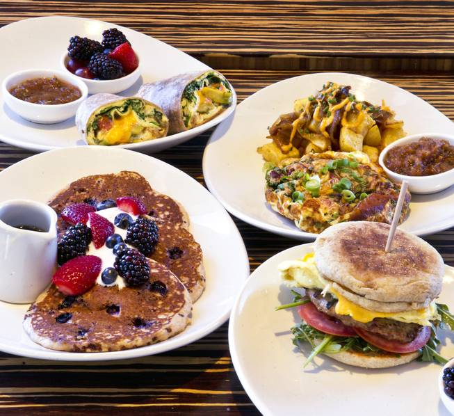 Quinoa buttermilk pancakes, breakfast burrito, spinach and avocado frittata with an egg and turkey sausage sandwich are some breakfast entrees at the LYFE Kitchen at The District on Thursday, July 24, 2014.