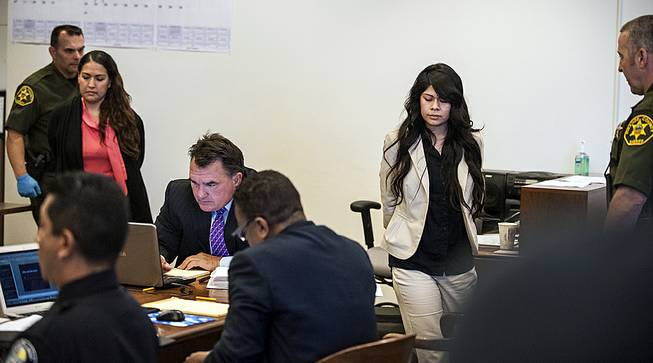 Candace Marie Brito, 27, left, and Vanesa Tapia Zavala, 26, enter court in Santa Ana, Calif., Wednesday morning, July 9, 2014, for the start of their trial.
