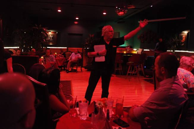 "Lee Mallory recites poetry at Ichabod's in Las Vegas. ""I want people to understand that poetry can be a touchstone in their lives, for their understanding of the world and their own growth,"" Mallory said."