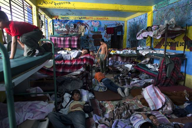 "AP10ThingsToSee - Boys watch television in their room at The Great Family group home, in Zamora, Mexico, Thursday, July 17, 2014. After a police raid on the refuse-strewn group home Tuesday, residents of the shelter told authorities that some employees beat residents, fed them rotting food or locked them in a tiny ""punishment"" room."
