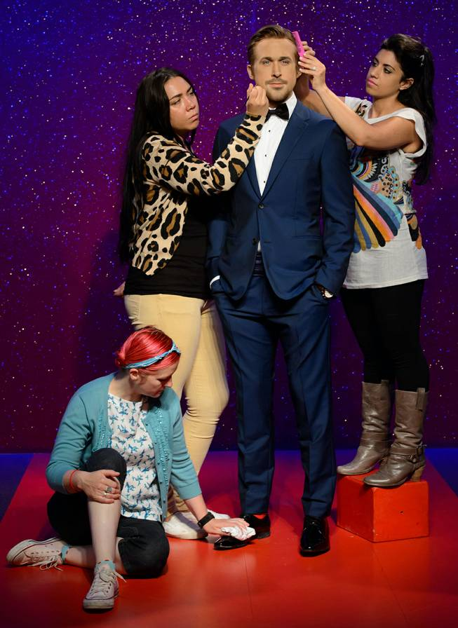 AP10ThingsToSee - Final adjustments are made to the wax figure of Canadian actor Ryan Gosling by Jane Anderson, left, Gemma Sim, center, and Caryn Bloom, right, at Madame Tussauds, London, Wednesday, July. 23, 2014.