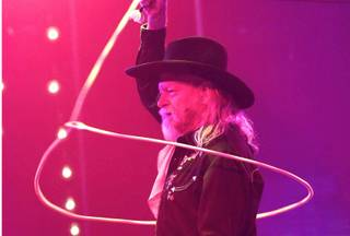 Rope-trick artist Chris McDaniel performs in Melody Sweets' video-release party for the music video